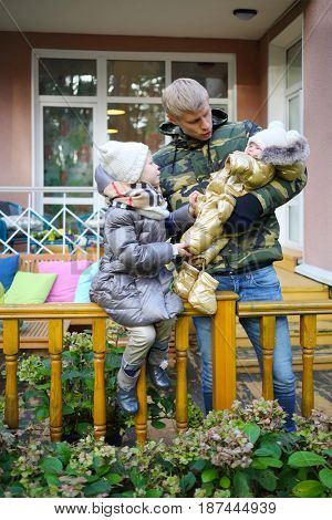 MOSCOW - OCT 25, 2016: Father, baby, girl (with MR) at terrace in summer residence of Mosdachtrest company, which manages summer houses fund, services and rents out-of-town property