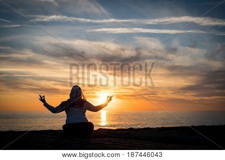 Man meditate at the beach
