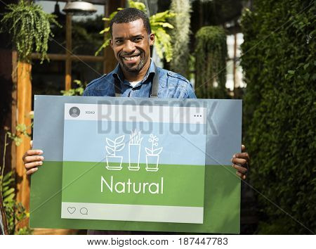 Man holding billboard network graphic overlay