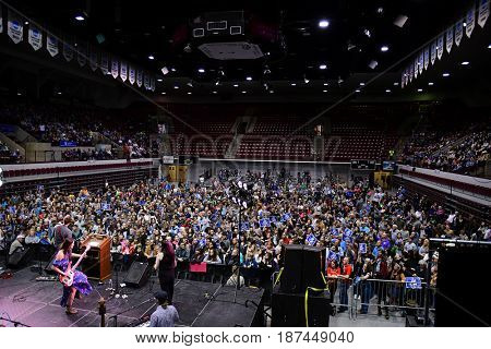 MISSOULA, MONTANA, USA - May 20, 2017: Daughter of US House candidate Rob Quist, Halladay Quist, performs with band before 4000 people, 2017 Montana special election rally at University of Montana