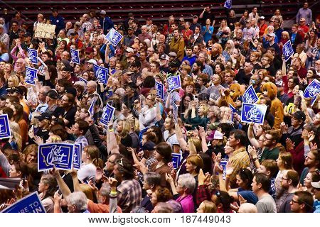 MISSOULA, MONTANA, USA - May 20, 2017: Crowd enthusiastically wave signs for US House of Representatives candidate Rob Quist at a 2017 Montana special election rally at University of Montana