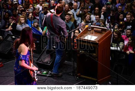 MISSOULA, MONTANA, USA - May 20, 2017: Daughter of US House candidate Rob Quist, Halladay Quist, performs with her band at the 2017 Montana special election rally at the University of Montana