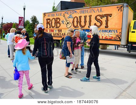 MISSOULA, MONTANA, USA - May 20, 2017: Supporters gathered near US House of Representatives candidate Rob Quistâ??s truck outside a 2017 Montana special election rally at University of Montana