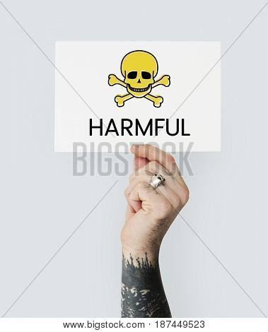 People holding placard with skull icon and chemicals dangerous