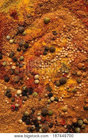 Abstract food texture made from a wide variety of spices in seed and powder form.