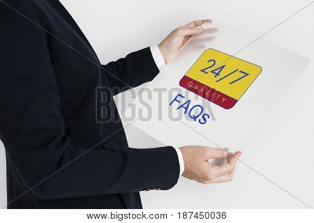 Business person holding 24/7 service banner