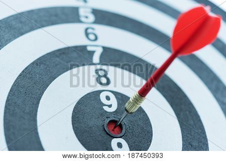 Red dart target arrow hitting on bullseye Metaphor to target marketing and business success concept