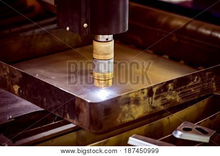 CNC Laser plasma cutting of metal, modern industrial technology.Small depth of field. Warning - authentic shooting in challenging conditions. A little bit grain and maybe blurred.