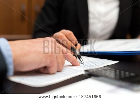 Detail of a writing businesswoman hand