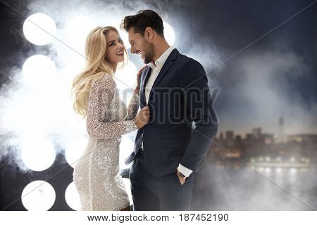 Attractive, laughing couple in the luxurious night club