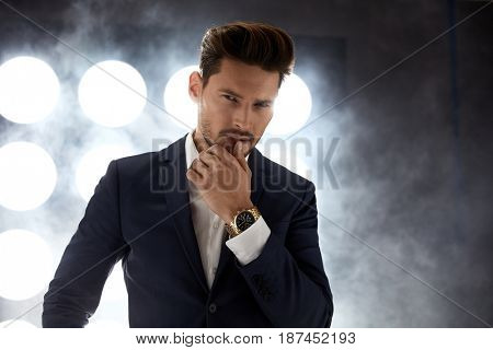 Portrait of a handsome, young guy in the night club
