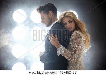 Adorable blond woman hugging a handsome guy