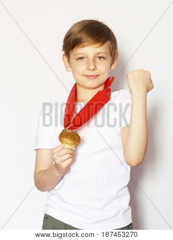 Cute blonde boy with gold medal winner