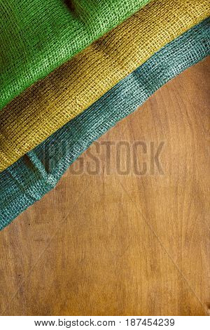 Three-color flag of Gabon on a wooden background.