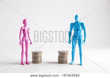 Male And Female Figurines Standing Next To Equal Piles Of Coins. Income Equality Concept
