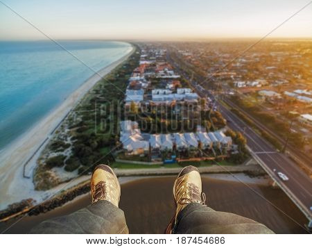 Feet Hanging Out Of Helicopter Above Patterson Lakes Suburb And Nepean Highway At Sunrise. Melbourne