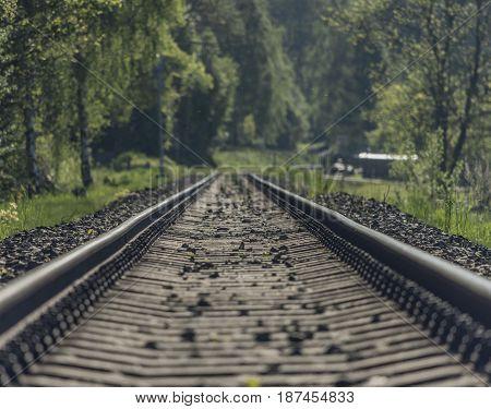 Railway track in spring fog sunny nice day