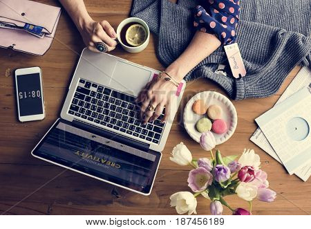 Woman Using Laptop Shopping Online