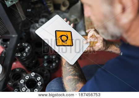 Man Using Tablet Searching Sawblade Attention Banner