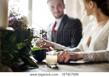 Bride and Groom Holding Hands on Wedding Reception
