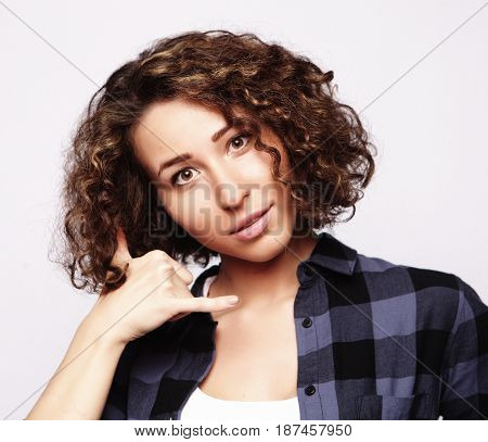 Portrait of attractive happy girl gesturing with fingers call me