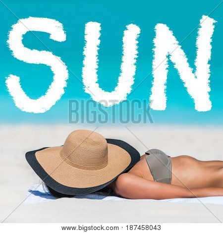 SUN word on beach background for summer holidays concept. Woman tanning lying down sleeping covering her face with hat for uv sun rays protection. Vacation girl relaxing on summer travel.