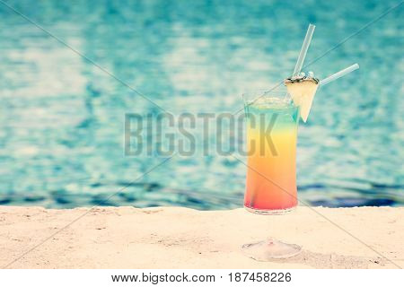 Rainbow Cocktail At The Edge Of A Resort Pool.  Concept Of Luxury Vacation