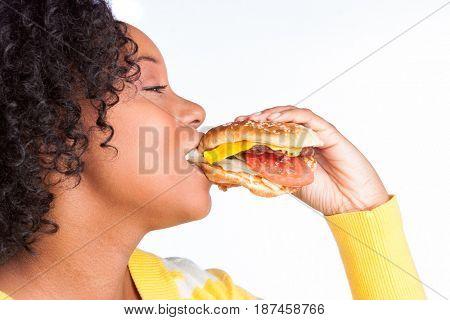Beautiful black woman eating burger