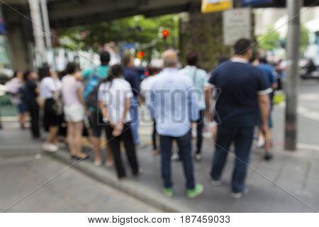 blurred scene of pedestrian in ratchaprasong junction in Bangkok Thailand