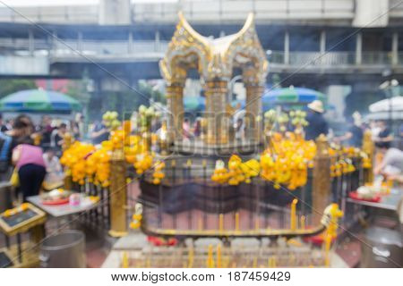blurred background of Erawan shrine in Ratchaprasong Junction in Bangkok Thailand. Erawan shrine is famous place in Ratchaprasong area