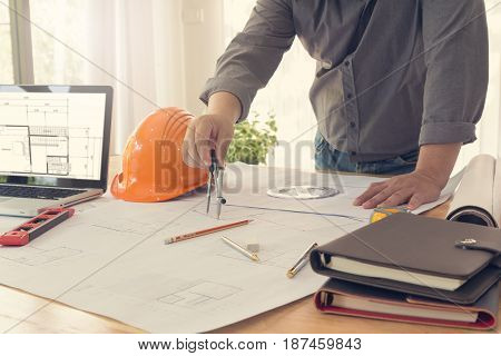 Architect Concept, Engineer And Architects Office Working With Blueprints