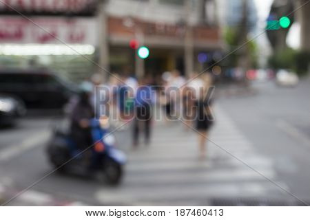 defocused scene of pedestrian walk across at Sukhumwit road in Bangkok Thailand