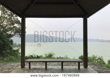 Water Dike, Mountain And Wooden Pavilion Seat
