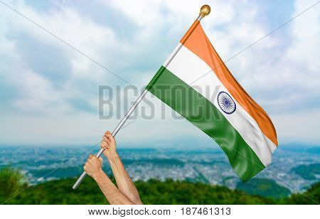 Young man's hands proudly waving the India national flag in the sky, part 3D rendering