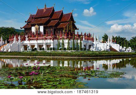 Ho Kham Luang Royal Pavilion and water lily pond at Royal Park Rajapruek in Chiang Mai, Thailand