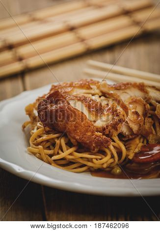 Chinese noodles with fry chicken meat and vegetables