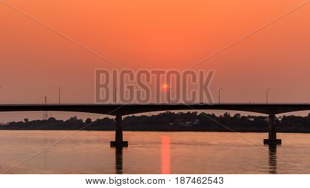 Bridge across the Mekong River at sunset. Thai-Lao friendship bridge at Nong Khai Thailand