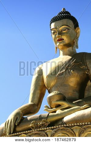 Buddha Dordenma statue on blue sky background Giant Buddha Thimphu Bhutan