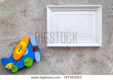 baby toys and frame for baby shower design on gray stone background top view mock-up