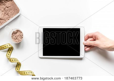 Sport and diet nutrition with equipment on white table background top view space for text
