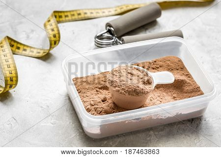 Sport and diet nutrition with equipment on stone table background top view
