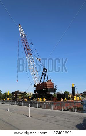 BROOKLYN, NEW YORK - MAY 21, 2017: Floating crane barge in Red Hook section of Brooklyn