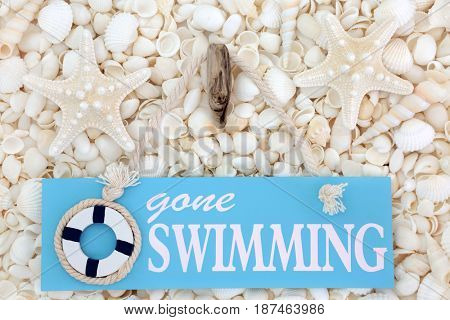 Gone swimming sign with starfish and white seashell assortment.