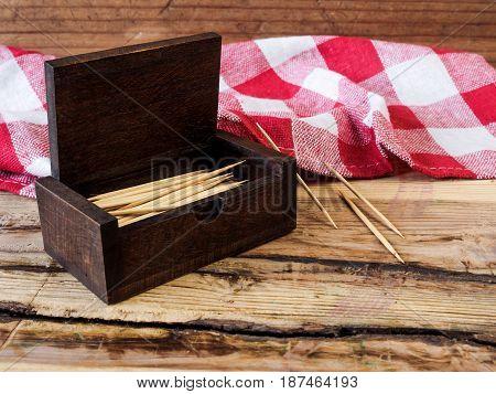 Box of toothpicks on vintage  wood background
