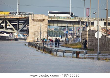 BUDAPEST, HUNGARY - JUNE 6, 2013: People at the flooding river Danube. Record breaking water level is expected in a few days.