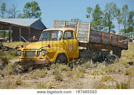 MILES, AUSTRALIA - MARCH 15, 2015: Abandoned antique lorry rotting in the outskirts of the town.