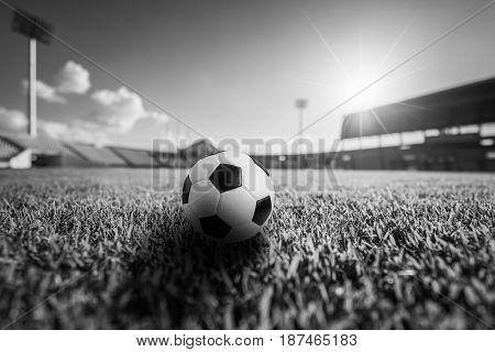 Soccer ball on the grass in soccer stadium. soccer ball concept background.
