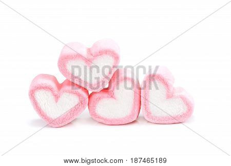Heart shape marshmallow with on background Pink heart shape marshmallow for love theme and Valentine background concept.Romance pink heart pastel color.