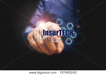 Insurance technology (Insurtech) concept businessman pressing text with virtual screen.