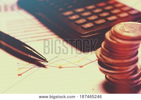 Finance savings concept business equipment on paperwork.